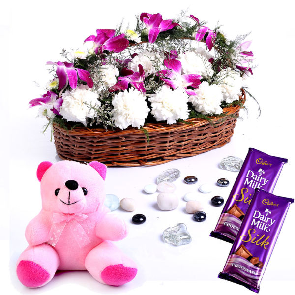 Buy Basket of Orchids and Carnations with Chocolates and Teddy Bear